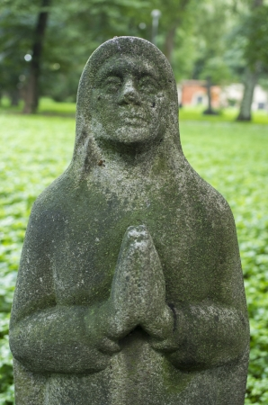 A statue of a praying mother Stock fotó