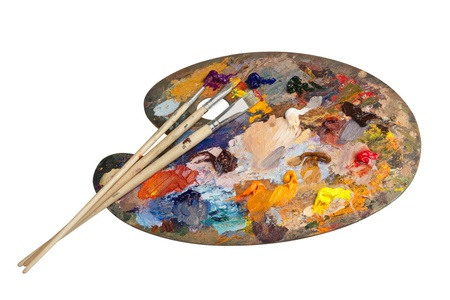 color mixing: Painting palette with brushes Stock Photo