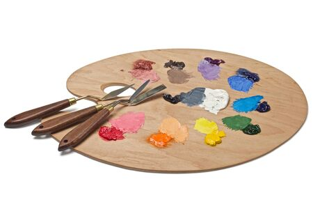 color mixing: Artist s palette with basic paints and palette knives