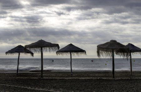 Umbrellas on a deserted beach photo