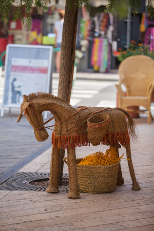 ass christmas: Straw Spanish donkey as a souvenir