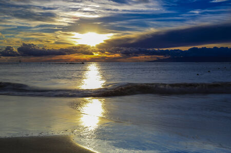 Sunset at the Atlantic with clouds on the horizon photo