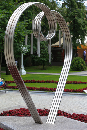 loveheart: Symbol Valentine Sweetheart in a city park in stainless steel. Stock Photo