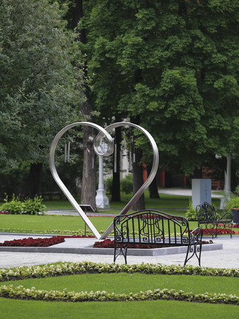 forbidden love: Symbol Valentine Sweetheart in a city park in stainless steel. Stock Photo