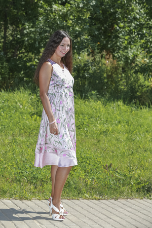 intelligent: Intelligent woman against the backdrop of nature rests Stock Photo