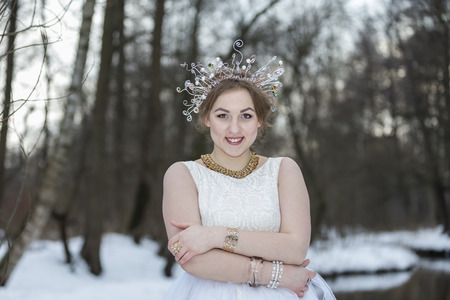 fantasize: Portrait of a young beautiful woman wearing a Crown Stock Photo