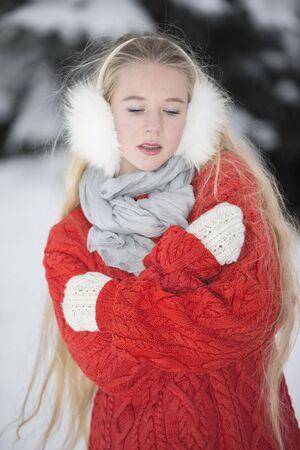 listens: Beautiful girl listens to music through headphones on the street Stock Photo