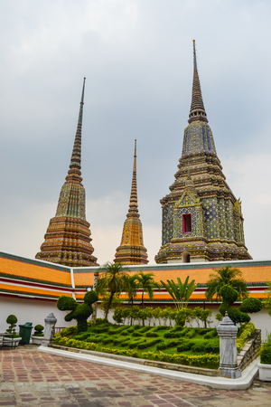 Thailand, Bangkok, Wat Pho is a Buddhist temple in Phra Nakhon district, Bangkok, Thailand. It is located in the Rattanakosin district directly adjacent to the Grand Palace