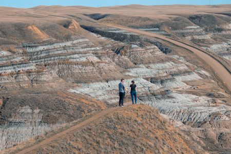 Drumheller HooDoos is a 0.5 kilometer heavily trafficked loop trail located near Drumheller, Alberta, Canada that features a cave, travel Alberta,Tourism. Stock Photo