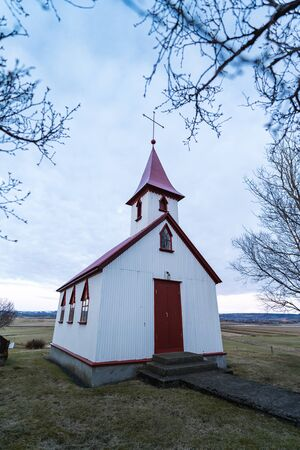 Typical red colored wooden church in Fludir town in south Iceland within the Golden Circle. Sunset light stock picture Banque d'images