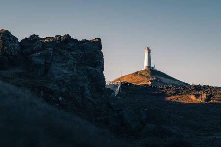 A popular Icelandic lighthouse Reykjanesviti is easily accessible from Reykjavik the capital town of Iceland. Golden hour at the Reykjanes peninsula. Tourism in Iceland
