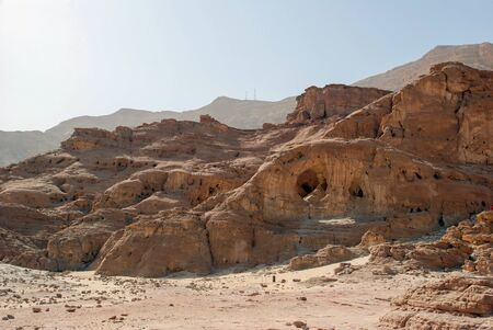 timna: View on the canyon of Timna park from arch made by wind in sandstone of geological formations, Israel
