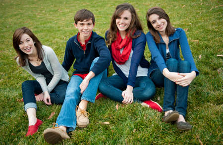 A group of four happy teenagers outside Stock Photo