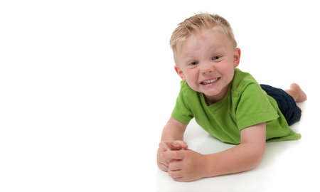 Young happy boy in a green shirt on a white background Stock Photo