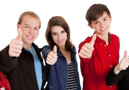 Three teenagers on a white background with their thumbs up