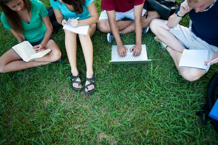 A group of four eenagers studying outside