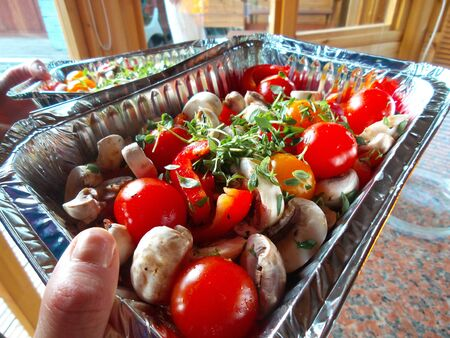 Barbecuing fresh cherry tomatoes and mushrooms