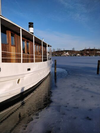 boat on the frozen lake at springtime Banco de Imagens