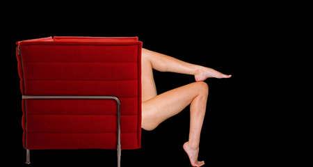 Female legs in a chair Stock Photo