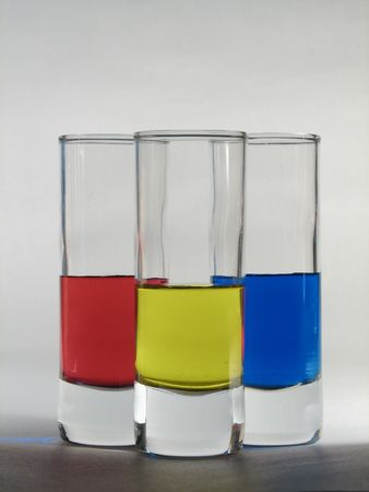 tots: tots with red, yellow and blue liqueurs Stock Photo