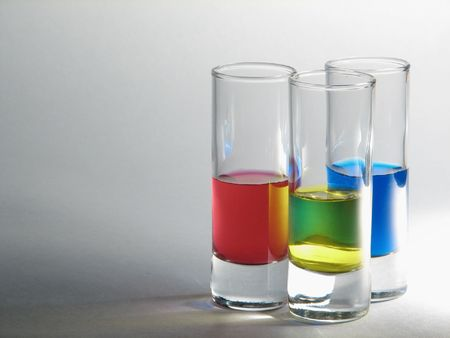 tots with red, yellow and blue liqueurs photo