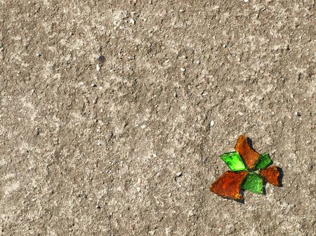 reminding: Orange And Green Glassy Chips Reminding Butterfly On Concrete Stock Photo