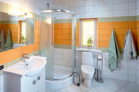 Interior of Washroom in Orange Tones in Dom in Koptevka Hotel 스톡 콘텐츠
