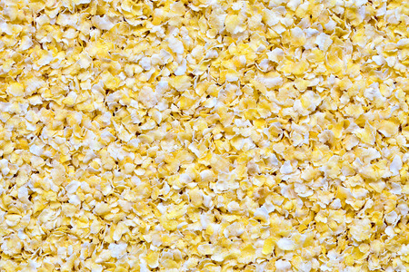 Background view of tasty crispy corn flakes texture