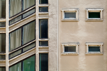 �¡onstruction background. Building with diagonal windows of stairwells with black frames. Example of Soviet architectural style Stockfoto