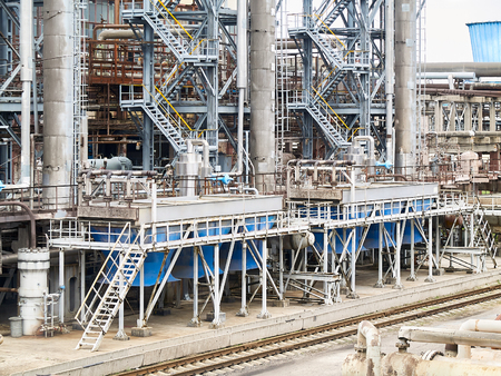 At modern chemical plant. Air cooling system with electric motors and synthesis columns of chemical production.