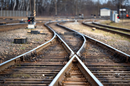 Large empty railroad fork. Concept of industrial logistic and transportation background with selected focus on center point and copy space. Banco de Imagens