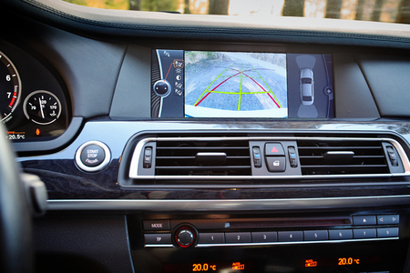 Interior of premium car with rearview camera dynamic trajectory turning lines and parking assistant. Driver assistance system for parking. Help assist options inside luxury car. Editorial