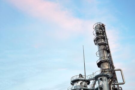 Oil refinery chemical plant bottom view with copy space against evening sky.