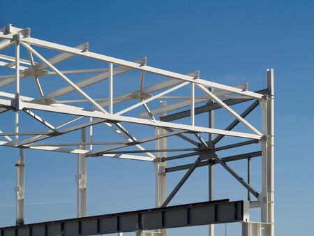 Background with metal structures fire protection coating over clear deep blue sky with copy space.