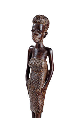 LUSAKA, ZAMBIA - NOVEMBER 2013: Typical examples of African art - African Statue of a Girl in a Dress Made of Mahogany Over White Knee Length 에디토리얼