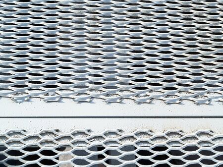 Perforated metal sheet stamping plates texture angled view. Made through metal stamping sheet metal manufacturing lightweight elements to loadbearing structural combine strength functionality
