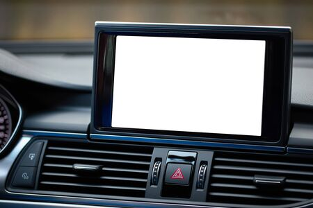 Monitor in car isolated blank screen for navigation maps and GPS rearview camera and parking assistant. Isolated on white with clipping path Car display with blank screen mock up copy space.