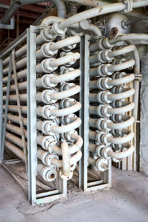 Chemical plant interior with equipment. Double Pipe Heat Exchanger or hairpin heat exchanger with longitudinal fins as an example of simplest form just pipe inside another larger pipe.