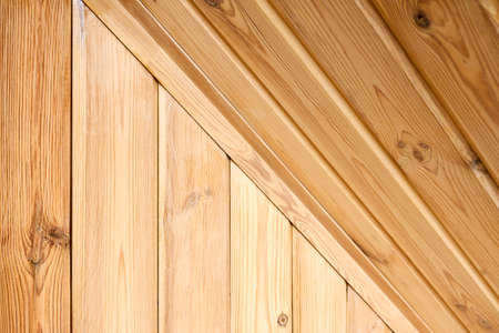 Interior carpentry background. Softwood clapboard, batten, plank timber blockhouse plank, or plank beam background with copyspace. Corner ceiling of rustic room finished with blockhouse or clapboard.