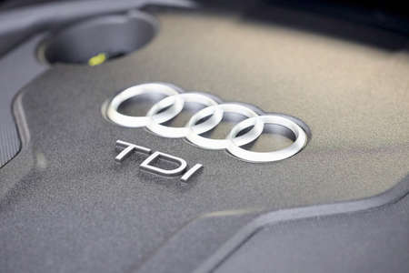 GRODNO, BELARUS - DECEMBER 2019: Audi A6 4G, C7 2.0 TDI 190 Hp 2016 Audi TDI sign logo on diesel motor compartment of modern luxury car with copyspace and sunflare.