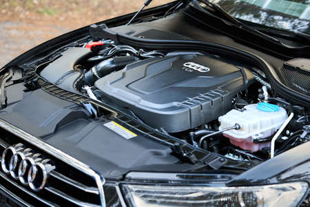 GRODNO, BELARUS - DECEMBER 2019: Audi A6 4G, C7 2.0 TDI 190 Hp 2016 diesel motor compartment of modern luxury car closeup engine left side view. Internal combustion engine, car parts, detailing.