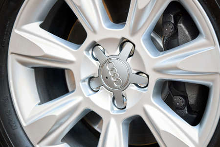 GRODNO, BELARUS - DECEMBER 2019: Audi A6 4G C7 Luxury car detailing closeup alloy wheel with winter tires side view with titanium look matt finish with caliper brake system. Editorial