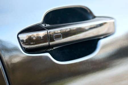 Luxury passenger car door handle with sensor. Doors locked and unlocked without operating master key closing door touching sensor safety concept.