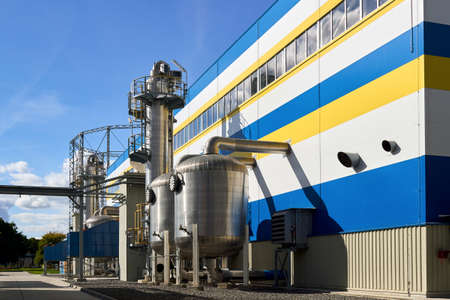 Petrochemical industrial architecture. Liquid oxygen nitrogen and air cryogenic industrial production building and equipment with scrubbers adsorbers and gasholder gas tank outdoors with copyspace. Standard-Bild