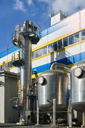 Petrochemical industrial architecture. Liquid oxygen nitrogen and air cryogenic industrial production building and equipment with scrubbers and adsorbers outdoors with copyspace vertical.