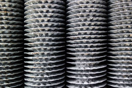 Condensing unit aluminium closeup finned obsolete tubes grill vertical texture, compressor and air conditioning system. Industrial background metal material for industry rib heater. Standard-Bild