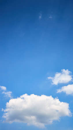 Cloud single lonely in high empty sky with beams vertical composition 16x9 with copyspace.
