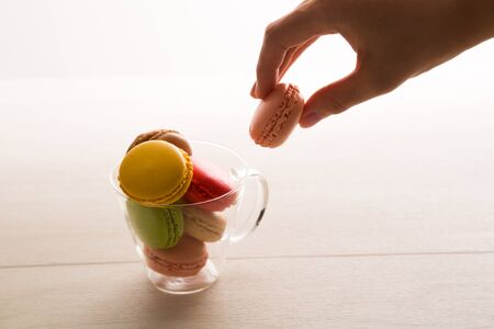 womens hands: Macaron and womens hands