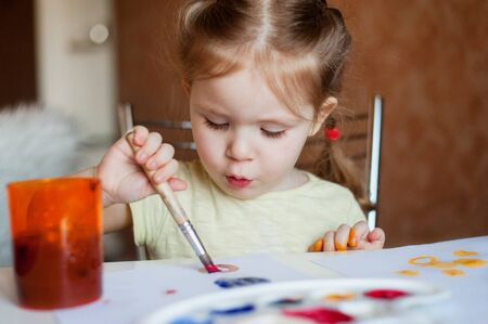 only baby girls: Little girl draws paints Stock Photo