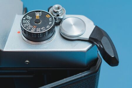 Close up on exposure counter, film advance lever, shutter release, film speed dial.